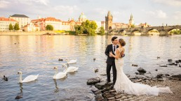 Just married couple posed near Charles bridge.